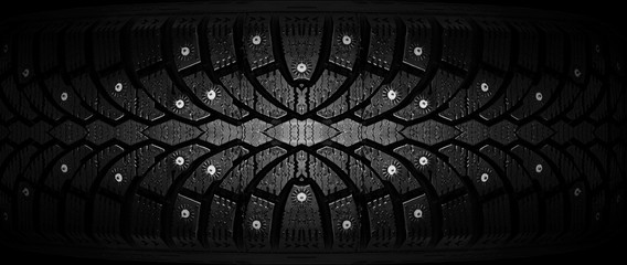 Winter rubber with spikes on a black background close-up.