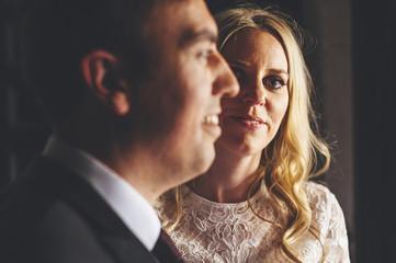 Portrait  confident bride close to her husband