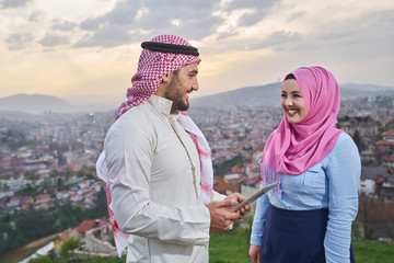 Muslim couple using tablet