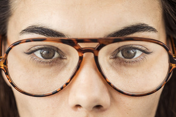 Close up of female eyes with glasses