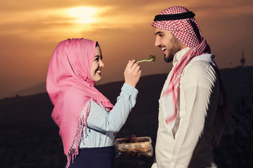Arabic couple fasting at sunset