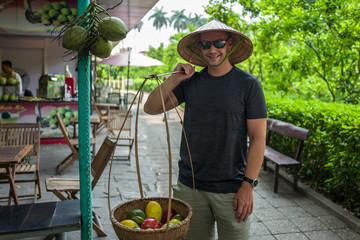 Caucasian man poses as street market seller in Hanoi, Vietnam