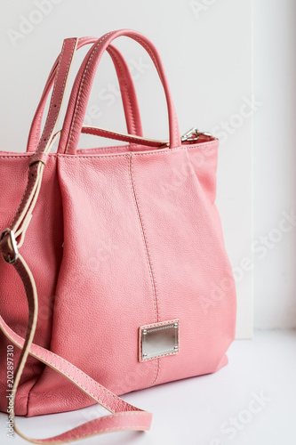 2b957512fa pink bag.Beautiful elegant and luxury fashion leather pink women handbag  isolated on white background