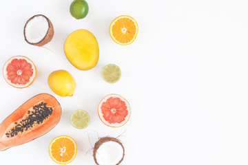 Summer tropical composition. Tropical fruits on white background. Summer concept. Flat lay, top view, copy space