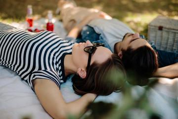 Woman with boyfriend relaxing at picnic