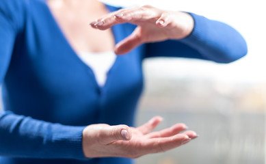 Hands of woman in gesture of protection