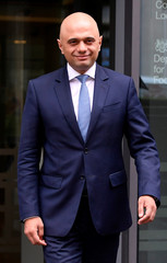 Sajid Javid stands outside the Home Office after being named as Britain's Home Secretary, in London