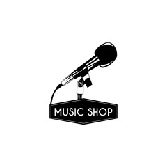 Microphone icon. Music shop logo label. Music store emblem. Vector.