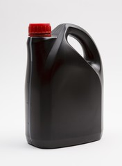 Bottle of engine oil, on a white background