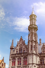 Tower of Provincial Palace in Bruges on sunny day