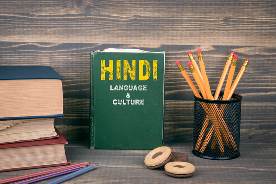 Hindi language and culture concept. Book on a wooden background