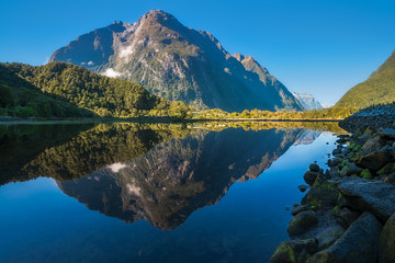 Mountain View Reflections in Water at Milford Sound in Fiordland National Park, New Zealand.