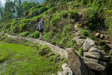 Caucasian girl trekking near Sapa, Vietnam.