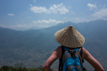 Caucasoan girl enjoys the view near Spa, Vietnam.