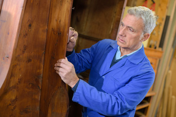 senior carpenter in is workshop