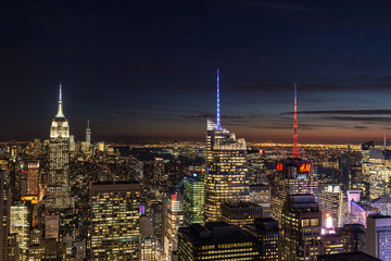 New York City skyline with urban skyscrapers at night.