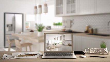 Architect designer desktop concept, laptop on wooden work desk with screen showing interior design project, blurred draft in the background, white kitchen idea template