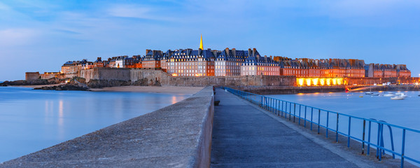 Wall Mural - Panoramic night view of walled city Saint-Malo with St Vincent Cathedral, famous port city of Privateers is known as city corsaire, Brittany, France