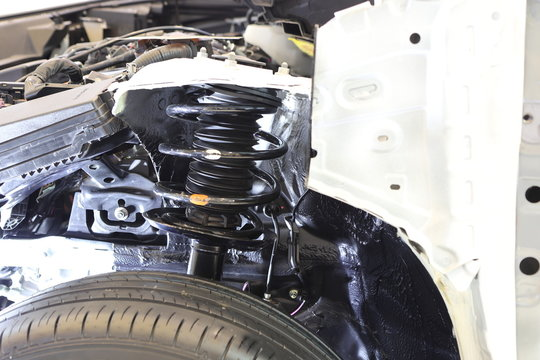 cross section of car show suspension system ; automotive industry background