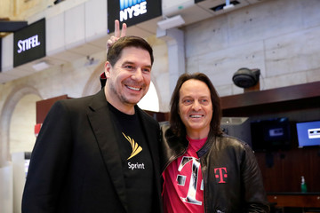 T-Mobile CEO John Legere and Sprint CEO Marcelo Claure pose for pictures on the floor of the New York Stock Exchange in New York