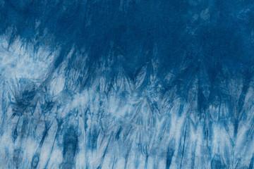 Dyed indigo fabric background and textured