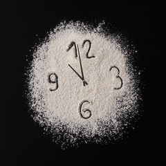 Creative concept photo of clock from flour with arrows. The concept of a healthy food