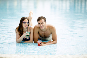 Couple in the swimming pool at summertime