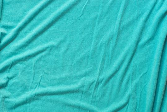 turquoise creased cotton fabric background texture