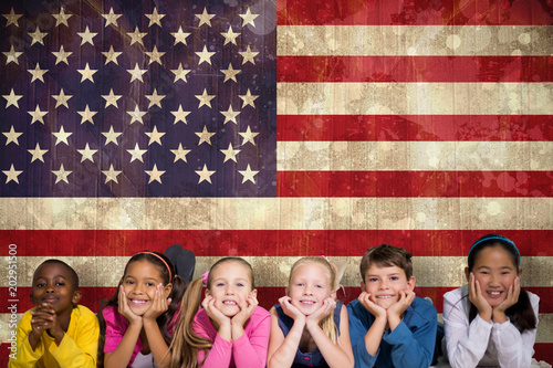 Grunge Camera Effect : Cute pupils smiling at camera against usa flag in grunge effect