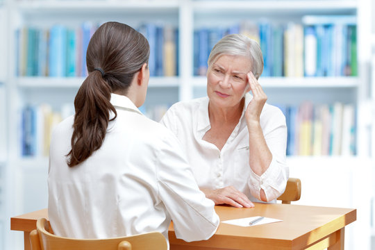 doctor senior patient headache migraine