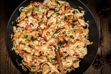 Fried rice with chicken served in a wok.