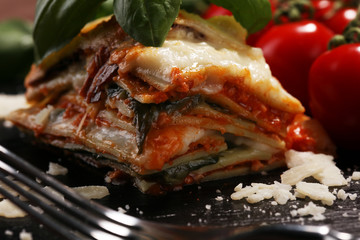 Serving of spicy traditional Italian beef lasagne in a restaurant