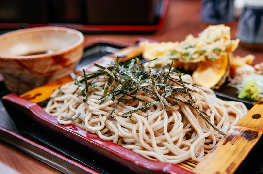 Japanese cold soba noodle on bamboo plate with Shrimp and vegetable tempura