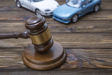 hammer of the judge. two collided cars. The concept of liability for traffic violations. Accident, insurance, compensation, crash.
