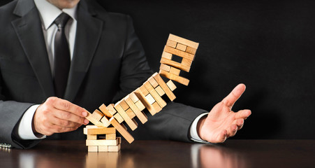 Businessman Fails Building Tower, Concept For Challenge And Fail In Business