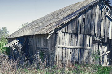 Old abandoned wooden shed of boards
