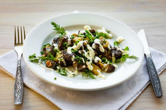 Mushrooms morel with sour cream sauce.  Exquisite dish. (Morchella Esculenta)