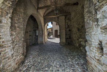 interior of an ancient medieval castle with stone walls