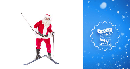 Portrait of happy santa claus skiing against blue vignette