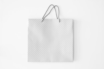 White spotted paper bag on white background