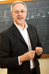 Music teacher smiling
