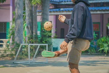 Students play sepak  takraw at noon after lunch.