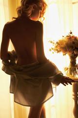Papiers peints womenART Sensual blonde at the window