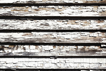 Background texture of blue wooden wall made of slats with gray chipped paint