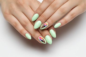 Poster de jardin Manicure mint, light green manicure on sharp long nails with painted ice cream