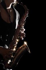 Photo sur Toile Musique Saxophone Player Saxophonist playing jazz music. Sax player