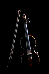 Violin isolated on black. Violin and bow