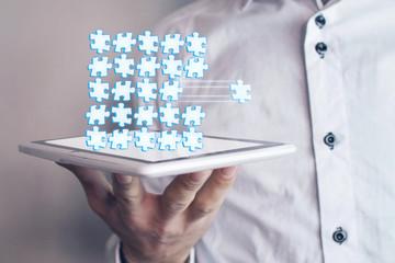 Man holding puzzle pieces. Teamwork concept