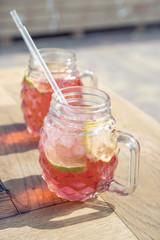 raspberry lemonade with lemon in wood table