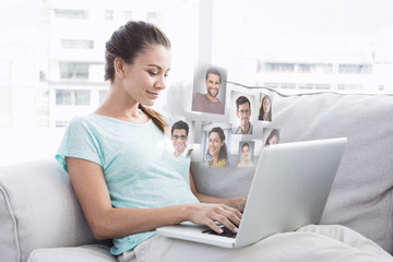 Happy woman sitting on couch using her laptop against profile pictures